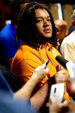 In this Aug. 21, 2019, photo, Tennessee tackle Marcus Tatum speaks during a media availability in Knoxville, Tenn. Tennessee's offensive linemen have taken plenty of lumps over the last two years from opposing pass rushers, the media and even their own fans. Now they're eager to take out their frustrations and change the narrative surrounding their recent results. (Calvin Mattheis/Knoxville News Sentinel via AP)