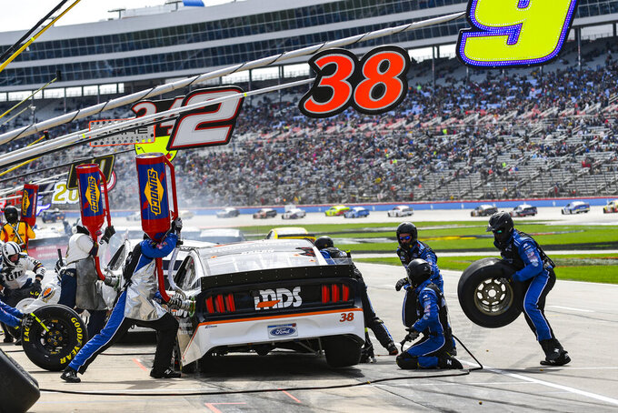 Driver David Ragan's (38) pit crew service his car during a NASCAR Cup auto race at Texas Motor Speedway, Sunday, March 31, 2019, in Fort Worth, Texas. (AP Photo/Randy Holt)