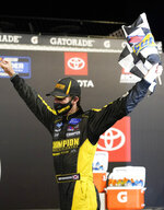 Grant Enfinger celebrates in Victory Lane after winning a NASCAR Truck Series auto race Thursday, Sept. 10, 2020, in Richmond, Va. (AP Photo/Steve Helber)