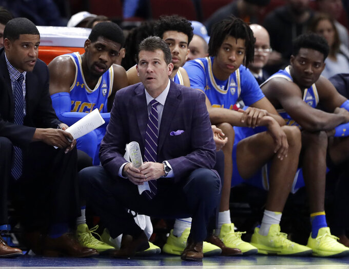 File-This Dec. 22, 2018, file photo shows UCLA head coach Steve Alford and his players watching during the second half of an NCAA college basketball game against Ohio State, in the fifth annual CBS Sports Classic, in Chicago.  Alford has been fired as UCLA basketball coach after six seasons, with the Bruins mired in a four-game skid that included losses at home to Belmont and Liberty. Athletic director Dan Guerrero said Monday, Dec. 31, 2018, that assistant Murry Bartow will serve as interim coach through the end of the season. (AP Photo/Nam Y. Huh, File)