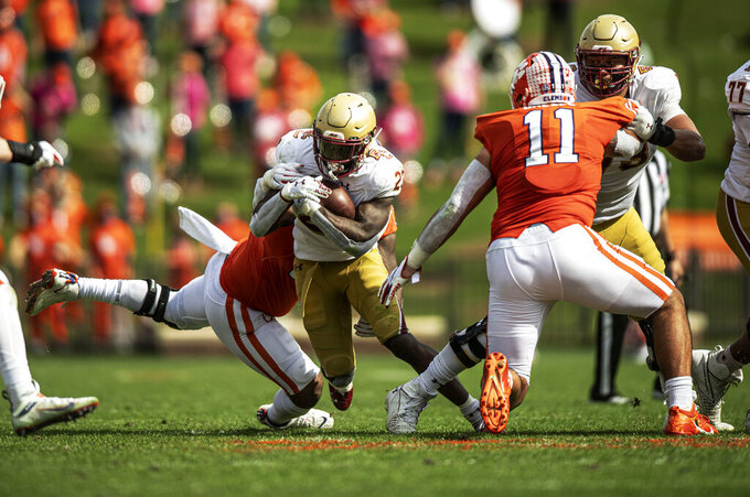 Clemson defensive tackle Jordan Williams (59) tackles Boston College running back Travis Levy (23) during the first half of an NCAA college football game  Saturday, Oct. 31, 2020, in Clemson, S.C. (Josh Morgan/Pool Photo via AP)