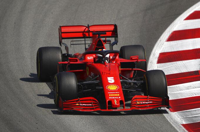 Ferrari driver Sebastian Vettel of Germany steers his car during the Formula One Grand Prix at the Barcelona Catalunya racetrack in Montmelo, Spain, Sunday, Aug. 16, 2020. (Bryn Lennon, Pool via AP)