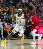 Virginia Commonwealth guard Mike'L Simms (1) drives around Jacksonville State point guard Ty Hudson (4) during the second half of an NCAA college basketball game Sunday, Nov. 17, 2019, in Richmond, Va. (AP Photo/Zach Gibson)