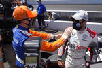 Marco Andretti is congratulated by Scott Dixon, of New Zealand, after Andretti won the pole for the Indianapolis 500 auto race at Indianapolis Motor Speedway, Sunday, Aug. 16, 2020, in Indianapolis. (AP Photo/Darron Cummings)
