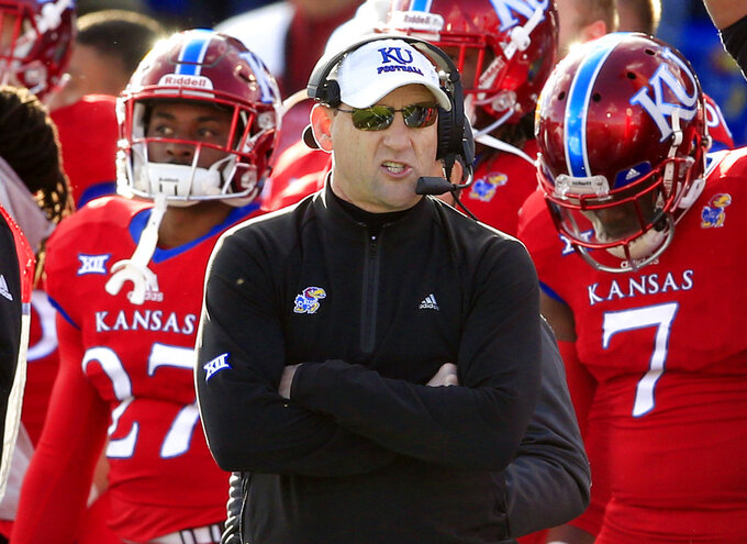 FILE - In this Nov. 18, 2017, file photo, Kansas head coach David Beaty watches during the first half of an NCAA college football game against Oklahoma in Lawrence, Kan. Kansas opens the season against Nicholls State on Saturday night with the future of coach Beaty likely on the line. (AP Photo/Orlin Wagner, File)