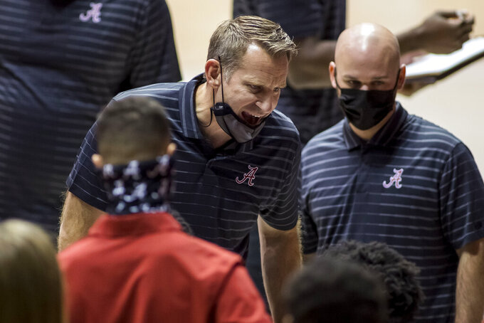 Alabama head coach Nate Oats tries to rally his players during the second half of an NCAA college basketball game against Western Kentucky, Saturday, Dec. 19, 2020, in Tuscaloosa, Ala. (AP Photo/Vasha Hunt)