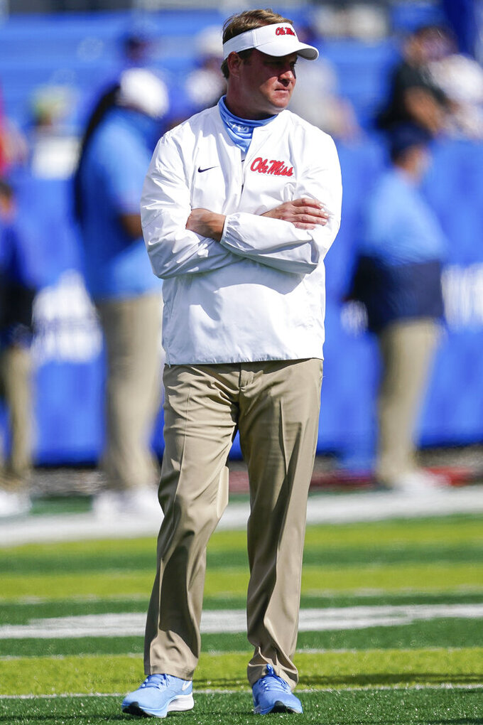 Mississippi head coach Lane Kiffin watches his team warm up before an NCAA college football game against Kentucky, Saturday, Oct. 3, 2020, in Lexington, Ky. (AP Photo/Bryan Woolston)