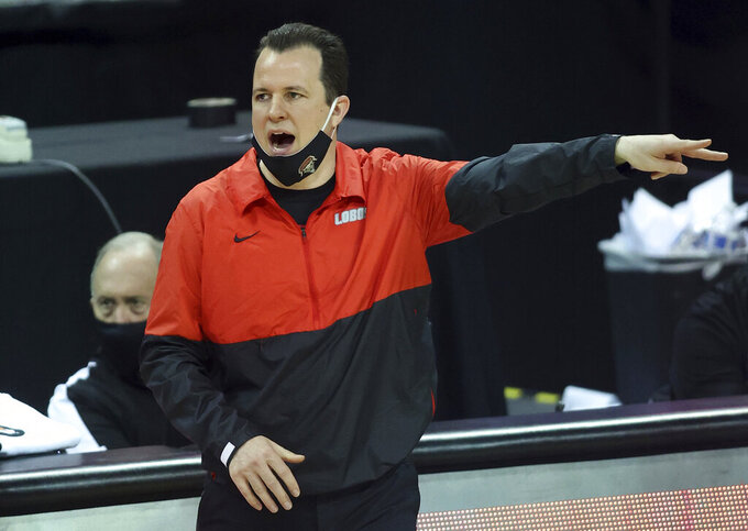 New Mexico coach Paul Weir gestures during the second half of the team's NCAA college basketball game against Fresno State in the first round of the Mountain West Conference men's tournament Wednesday, March 10, 2021, in Las Vegas. (AP Photo/Isaac Brekken)