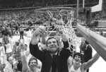 FILE - In this March 29, 1982, file photo, North Carolina basketball coach Dean Smith cuts the net as happy players and fans cheer after the Tar Heels defeated Georgetown for the NCAA  college basketball Final Four championship, in New Orleans. The NCAA championship was the only thing missing from Smith's trophy case in an otherwise brilliant career that includes one of the best records in coaching — 468-145 over 21 years in Chapel Hill — an Olympic gold medal and acknowledgment by peers of his basketball greatness. (AP Photo/Pete Leabo, File)
