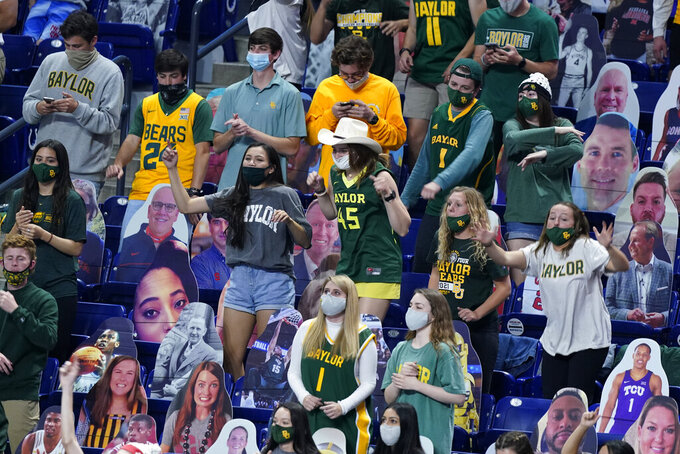 Baylor fans celebrate during the second half of the championship game against Gonzaga in the men's Final Four NCAA college basketball tournament, Monday, April 5, 2021, at Lucas Oil Stadium in Indianapolis. (AP Photo/Michael Conroy)