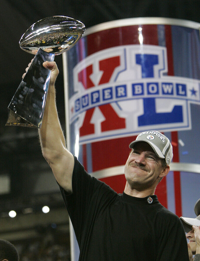 FILE - In this Feb. 5, 2006, file photo, Pittsburgh Steelers head coach Bill Cowher lifts the Vince Lombardi Trophy after his team defeated the Seattle Seahawks, 21-10, in the Super Bowl XL NFL football game in Detroit. Five Super Bowl-winning coaches, including Cowher, are among the finalists for the Pro Football Hall of Fame's special centennial class announced Thursday, Dec. 19, 2019. A 25-member panel of pro football experts is charged with selecting 10 senior players, two coaches and three contributors who will be inducted into the Canton, Ohio shrine next year as part of the league's celebration of its 100th season.   (AP Photo/Gene J. Puskar, File)