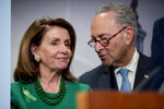 Senate Minority Leader Sen. Chuck Schumer of N.Y., right, and House Minority Leader Nancy Pelosi of Calif., left, speak together during a news conference on Capitol Hill in Washington, Wednesday, May 16, 2018, after the Senate passes a resolution to reverse the FCC decision to end net neutrality. (AP Photo/Andrew Harnik)