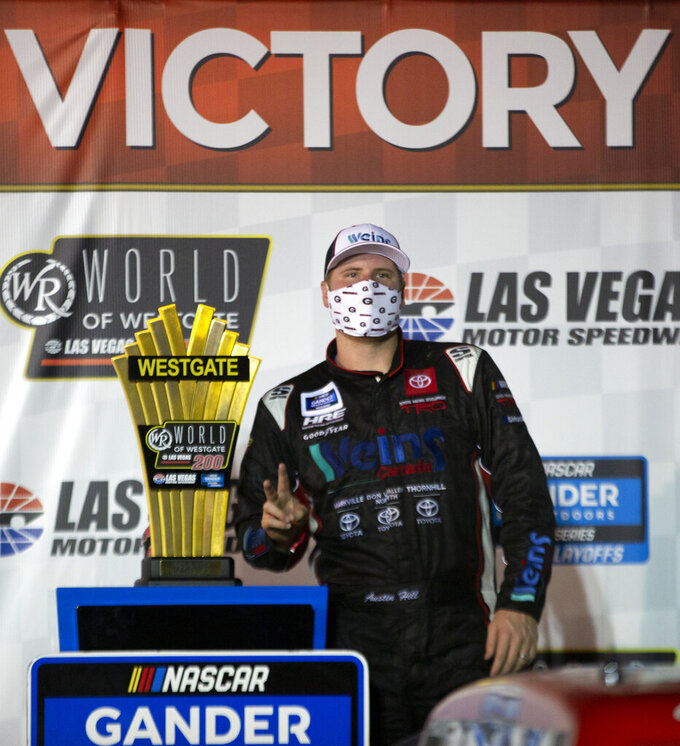 Austin Hill (16) poses in Victory Lane after winning the NASCAR Westgate 200 auto race at Las Vegas Motor Speedway, Friday, Sept. 25, 2020, in Las Vegas. (Ellen Schmidt/Las Vegas Review-Journal via AP)