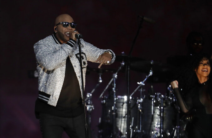 Artist Flo Rida performs during the half time show at the Orange Bowl NCAA college football game between Alabama and Oklahoma , Saturday, Dec. 29, 2018, in Miami Gardens, Fla. (AP Photo/Lynne Sladky)