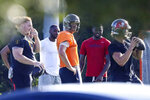 FILE - This June 23, 2020, file photo shows Tampa Bay Buccaneers center Ryan Jensen, far left, along with safety Mike Edwards, second from left, quarterback Tom Brady, center in orange, cornerback Jamel Dean, second from right, and quarterback Blaine Gabbert during a private workout at Berkeley Preparatory School in Tampa, Fla. In a normal year, Brady's switch from the Patriots to the Buccaneers would have overridden every NFL story, from early winter through the spring and summer and into his debut against fellow 40-something QB Drew Brees and the Saints in September. Perhaps the biggest headlines Brady drew recently came when he defied players' union recommendations to cease informal practices with teammates as a coronavirus precaution. (Chris Urso/Tampa Bay Times via AP, File)
