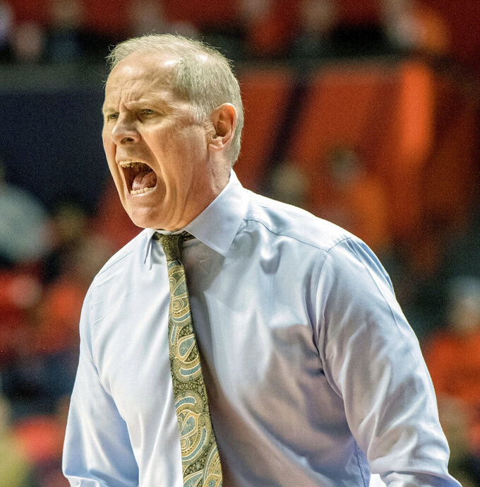 Michigan coach John Beilein complains about a call during the second half of the team's NCAA college basketball game against Illinois in Champaign, Ill., Thursday, Jan. 10, 2019. Michigan won 79-69. (AP Photo/Rick Danzl)