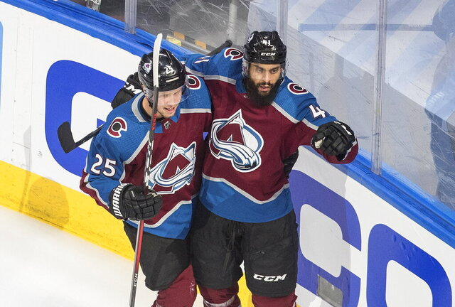 Colorado Avalanche's Pierre-Edouard Bellemare (41) celebrates his goal with teammate Logan O'Connor (25) against the Dallas Stars during the first period of an NHL Western Conference Stanley Cup playoff game, Monday, Aug. 31, 2020, in Edmonton, Alberta. (Jason Franson/The Canadian Press via AP)