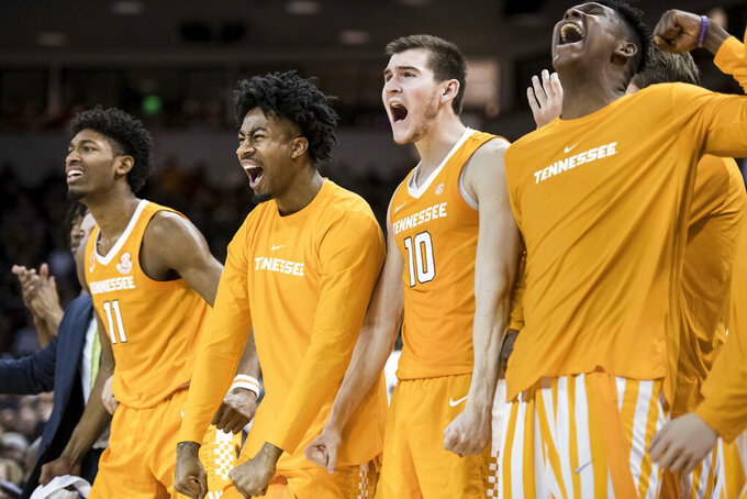 Tennessee forward John Fulkerson (10), Jordan Bowden and Kyle Alexander (11) celebrate a basket against South Carolina during the second half of an NCAA college basketball game Tuesday, Jan. 29, 2019, in Columbia, S.C. Tennessee defeated South Carolina 92-70. (AP Photo/Sean Rayford)