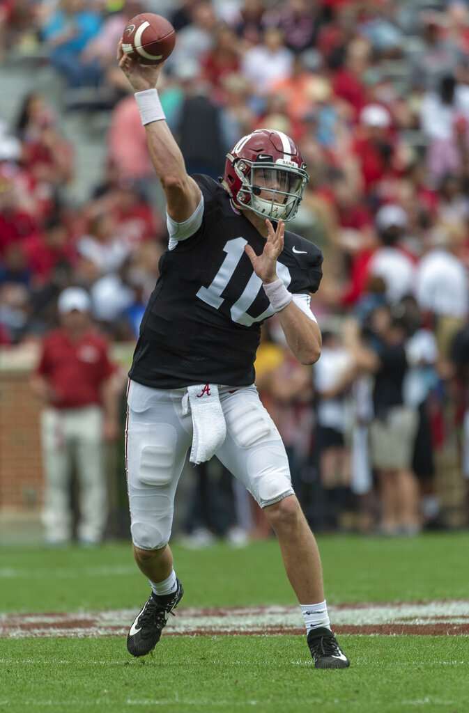 Alabama quarterback Mac Jones (10) throws a sideline pass during the first half of Alabama's A-Day NCAA college football scrimmage, Saturday, April 13, 2019, in Tuscaloosa, Ala. (AP Photo/Vasha Hunt)