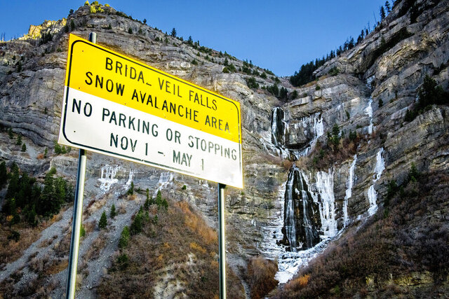 Water cascades down Bridal Veil Falls in Provo Canyon, Utah, Tuesday, Dec. 1, 2020. On Tuesday, the Provo Municipal Council voted on a resolution seeking to keep the falls area in its natural state and maintain the falls for public recreational use. (Isaac Hale/The Daily Herald via AP)