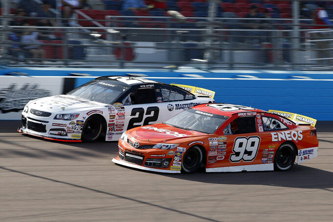 Gracie Trotter (99) and Kris Wright (22) race through Turn 4 during the ARCA Series auto race at Phoenix Raceway, Saturday, Nov. 7, 2020, in Avondale, Ariz. (AP Photo/Ralph Freso)