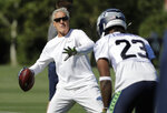 Seattle Seahawks head coach Pete Carroll throws a football during NFL football training camp, Thursday, July 25, 2019, in Renton, Wash. (AP Photo/Ted S. Warren)