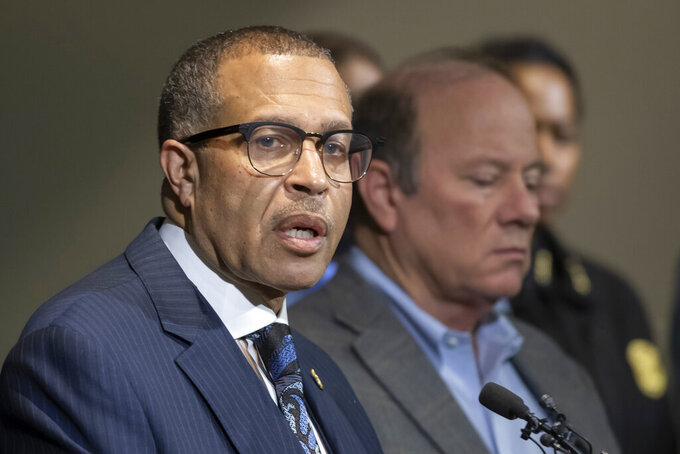FILE - In this Nov. 21, 2019, file photo, Detroit Police Chief James Craig, left, speaks to the media at Detroit Public Safety Headquarters in Detroit.  Craig has scheduled a news conference Monday May 10, 2021, to announce his retirement as head of Detroit's police department and to possibly discuss his future plans which could include a run for political office. (David Guralnick/Detroit News via AP, File)