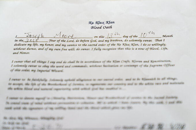 """A KKK """"blood oath"""" signed by Joseph Moore is photographed at the Columbia County Courthouse in Lake City, Fla., Friday, April 16, 2021. On Jan. 30, 2015, less than two years after Moore had signed it, a murder plot with other klansmen was in motion, and he was involved. (AP Photo/David Goldman)"""
