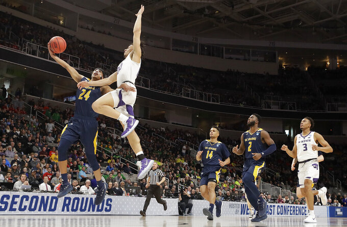 UC Irvine guard Eyassu Worku (24) shoots against Kansas State guard Mike McGuirl during the second half of a first round men's college basketball game in the NCAA Tournament Friday, March 22, 2019, in San Jose, Calif. (AP Photo/Chris Carlson)