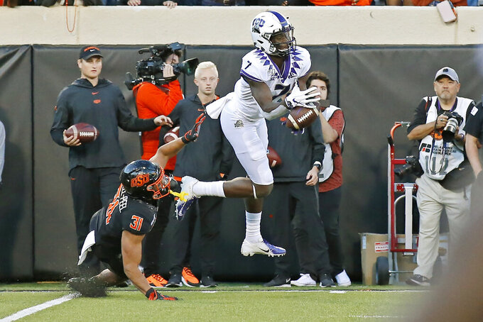 TCU wide receiver John Stephens Jr. (7) can't hold onto a pass in front of Oklahoma State safety Kolby Harvell-Peel (31) in the second half of an NCAA college football game in Stillwater, Okla., Saturday, Nov. 2, 2019. (AP Photo/Sue Ogrocki)