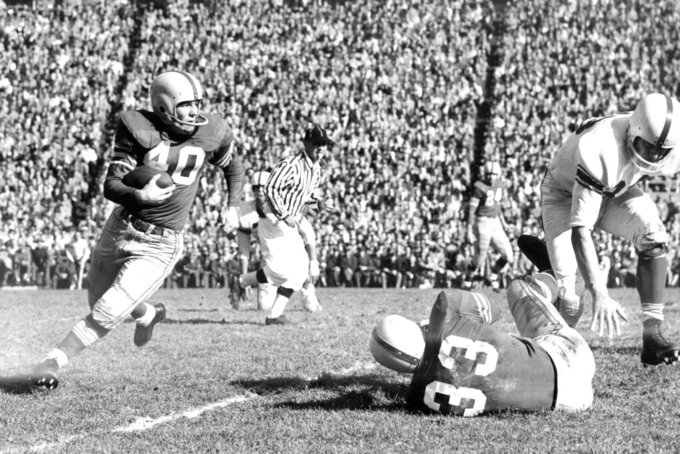 "FILE - In this Nov. 1955, file photo, Ohio State halfback Howard ""Hopalong"" Cassady (40) carries the ball against Indiana during a college football game in Columbus, Ohio. Cassady, a Heisman Trophy winner and former NFL running back, died early Friday, Sept. 20, 2019, in Tampa, Fla.,  Jerry Emig, the Ohio State associate athletic director said. He was 85. Cassady played both football and baseball at Ohio State in the early 1950s, winning the Heisman Trophy in 1955. He also played 10 seasons in the NFL, mostly with the Detroit, and got the nickname ""Hopalong"" from local sports writers after the black-hatted Western star of the 1950s.  (AP photo)"
