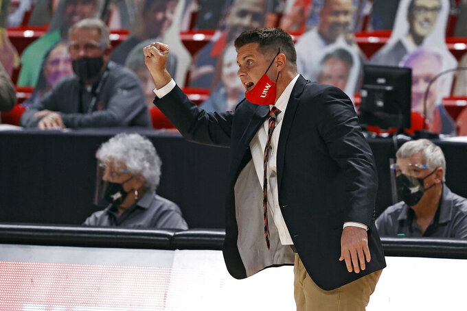 Incarnate Word coach Carson Cunningham yells out to his players during the first half of an NCAA college basketball game against Texas Tech, Tuesday, Dec. 29, 2020, in Lubbock, Texas. (AP Photo/Brad Tollefson)