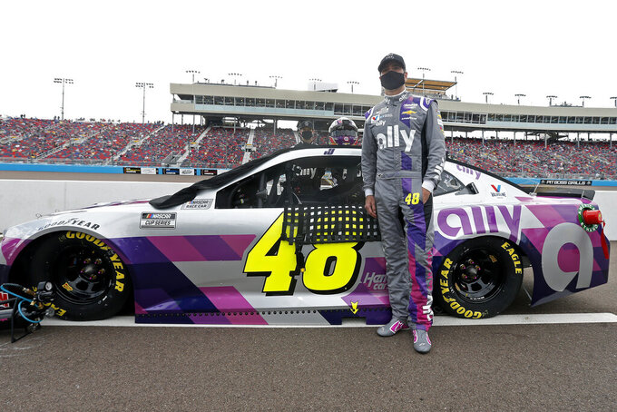 Jimmie Johnson stands with his race car on pit road prior to the NASCAR Cup Series auto race at Phoenix Raceway, Sunday, Nov. 8, 2020, in Avondale, Ariz. (AP Photo/Ralph Freso)