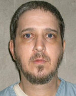 FILE - This undated file photo provided by the Oklahoma Department of Corrections shows death row inmate Richard Glossip. Glossip was convicted of ordering the beating death of Oklahoma City motel owner Barry Van Treese in 1997 and was sentenced to die. (Oklahoma Department of Corrections via AP, File)